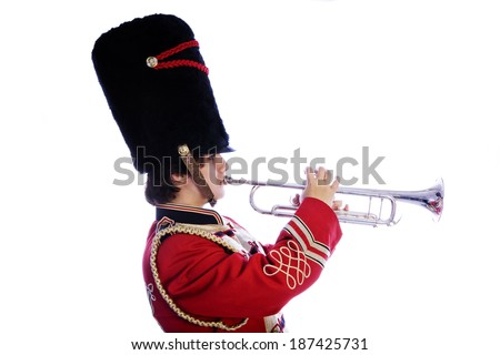 Person in red gold and black marching band uniform with playing trumpet side view isolated on white background