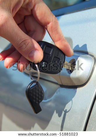 Person Inserting Car Key - stock photo