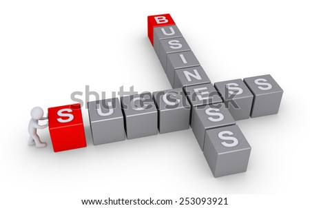 Person is pushing the last cube in order to finish the success and business crossword - stock photo