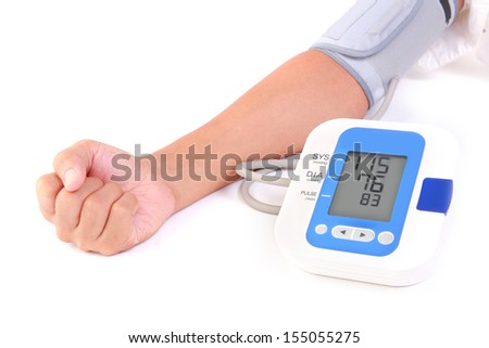 person is using sphygmomanometer for check his health - stock photo