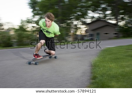 person long boarding around a sharp curve