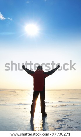Person on background sun. Bright solar glow and blue sky - stock photo