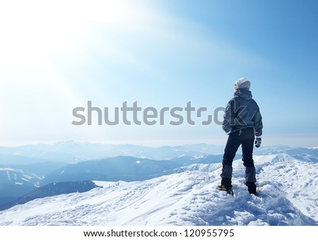 Person on snow top and sunshine. Sport and active life - stock photo