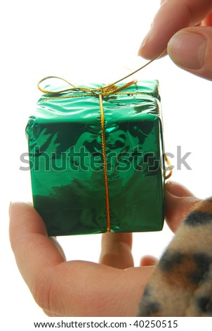 person opening gift isolated on white, focus on present. - stock photo