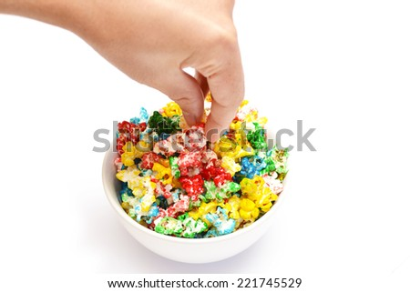 Person picking colors popcorn bowl