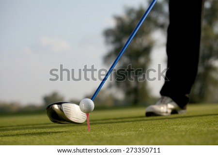 Person playing golf, low section - stock photo