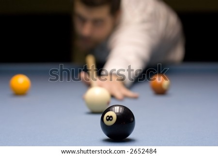 Person playing snooker in a club with a shallow DOF - stock photo