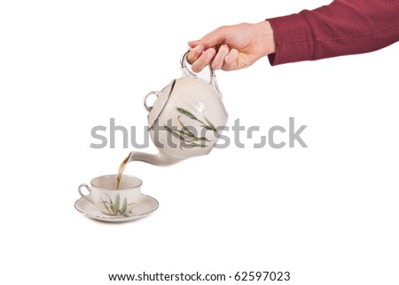 person pours tea into cup isolated on white for your text