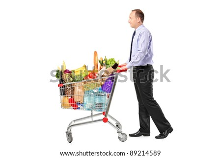 Person pushing a shopping cart full with groceries isolated on white background