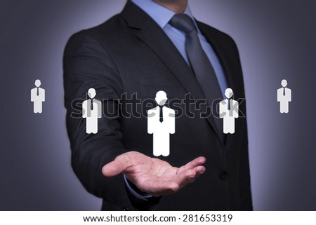Person pushing hologram of human resource icon - stock photo