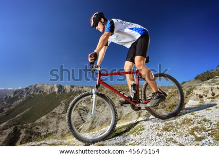 Person riding a bike downhill style