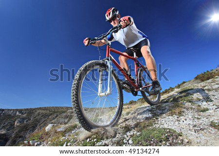 Person riding a bike downhill style - stock photo