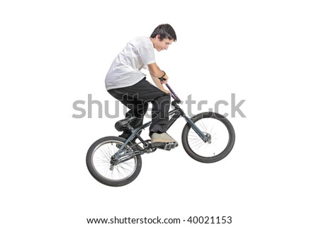 Person riding a bike in jump isolated against white background - stock photo