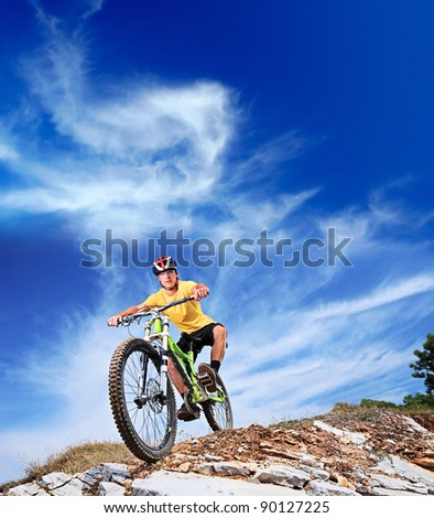 Person riding a mountiain bike on a slope - stock photo