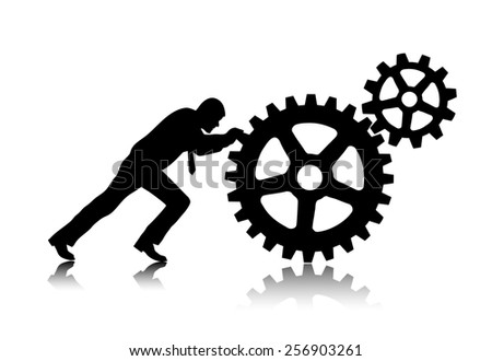 person rotates gear wheels