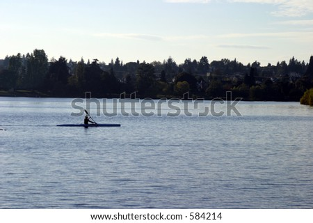person rows on seattles green lake