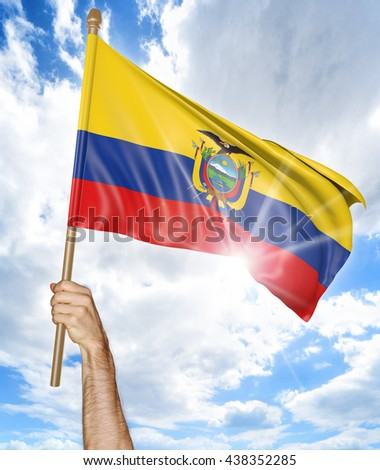 Person's hand holding the Ecuadorian national flag and waving it in the sky, 3D rendering - stock photo