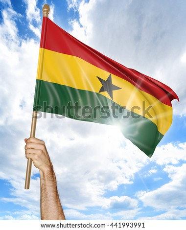 Person's hand holding the Ghana national flag and waving it in the sky, 3D rendering - stock photo