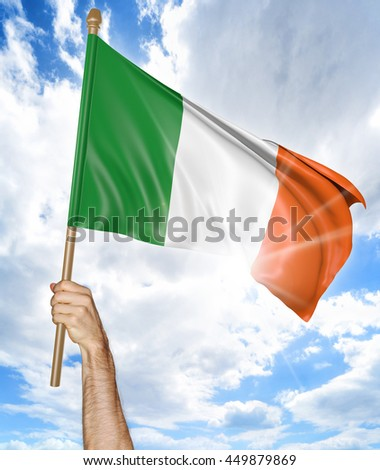 Person's hand holding the Irish national flag and waving it in the sky, 3D rendering - stock photo