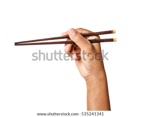 Person 's right hand using bamboo chopsticks isolated on white background, Saved clipping path.