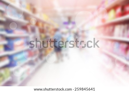 Person Shopping In Retail Store Blurred Background  - stock photo