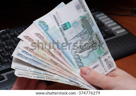 person shows money rubles