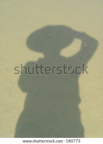 Person silhouette in murky still waters - stock photo