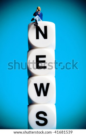person sitting on word news written with dices - stock photo
