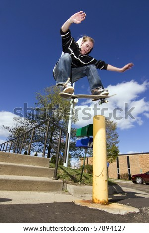 person skateboarding, doing a trick