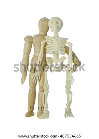 Person standing next to a skeleton - path included - stock photo