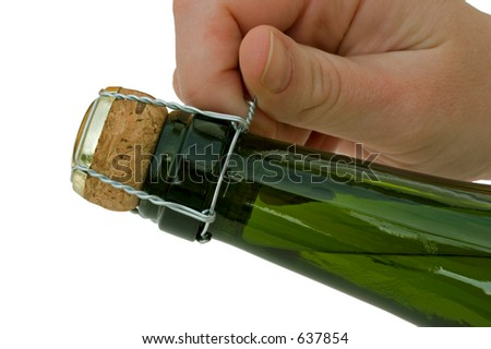 Person starting to undo the wire on a bottle of Champagne. - stock photo