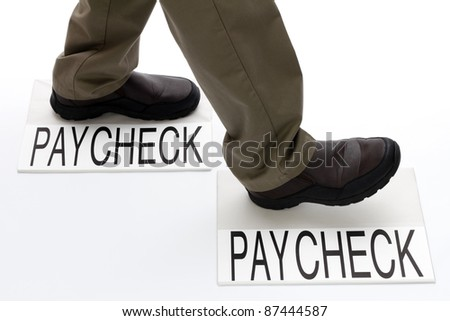Person stepping from one paycheck to another paycheck. - stock photo