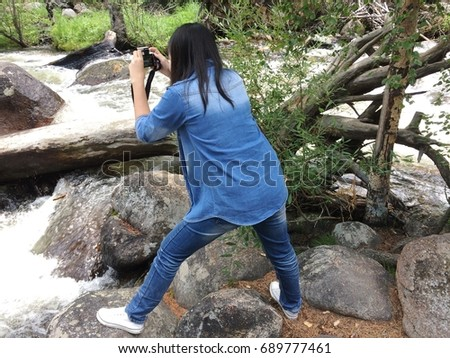 Person take picture with camera at outdoor