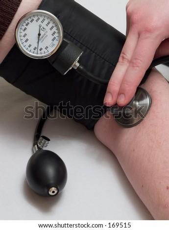Person taking blood pressure with sphygmomanometer