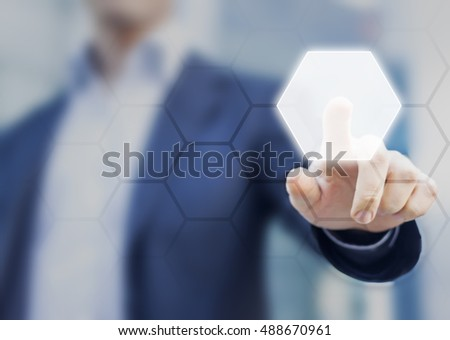 Person touching an hexagonal button on a digital interface. Concept about technology and choices