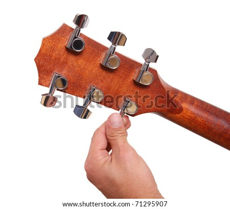 Person tuning a guitar from its  headstock over white background - stock photo