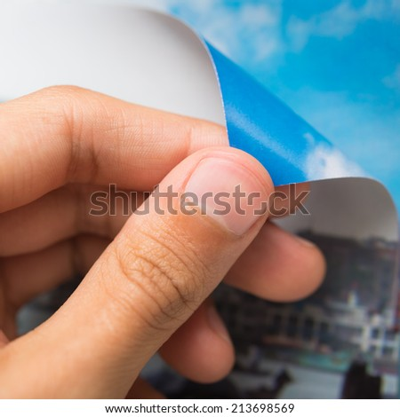 Person turning the page of a book - stock photo