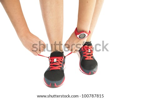 Person tying sneakers on a white background - stock photo