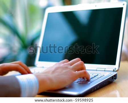 Person Typing on a modern laptop in an office - stock photo