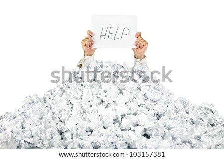 Person under crumpled pile of papers with hand holding a help sign / isolated on white