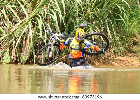Person up hold bike in mountain bike game. - stock photo