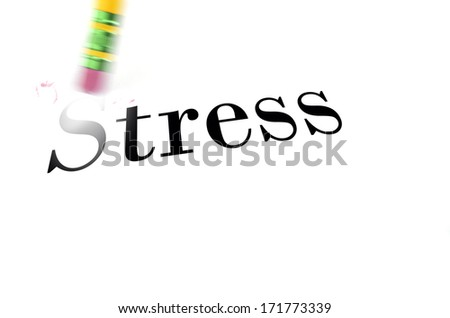 Person using a pencil eraser to erase Stress from their life so they can start new - stock photo