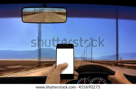 Person using smart phone GPS while driving - stock photo