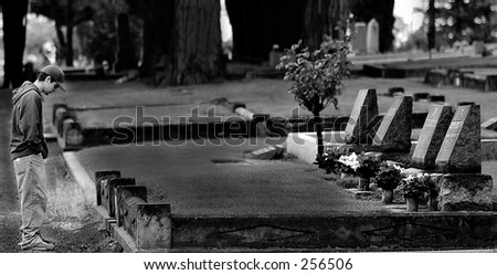 Person visiting cemetary - stock photo
