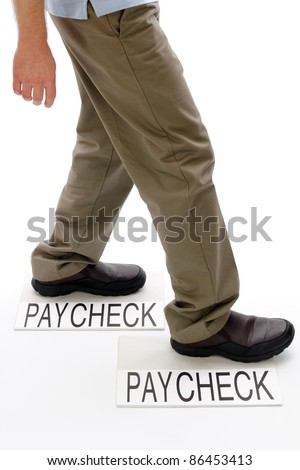 Person walking from one light gray rectangle paper packet marked paycheck to another with text saying paycheck on white ground. - stock photo