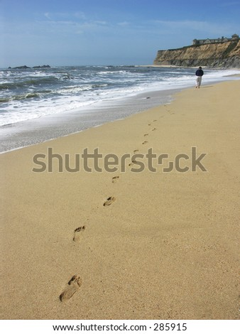 Person Walking on Beach - stock photo