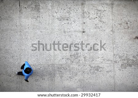 person walking top view on sidewalk - stock photo