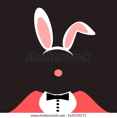 person wearing rabbit ears and tuxedo - stock photo