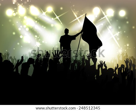 person with a flag among active public against searchlights - stock photo