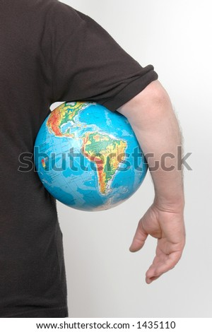 person with globe in hand. - stock photo